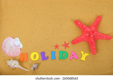 "Word ""holidays"" and starfish on sand close up"