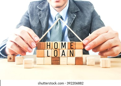 word home loan on home wood cubes and business man background