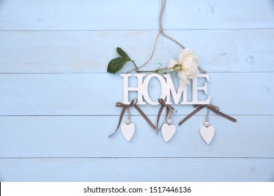 The word Home made of wood with pastel background. Decorate your home
