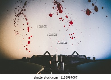 The word horror typed on blood stained paper