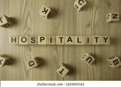 Word hospitality from wooden blocks on desk, business concept