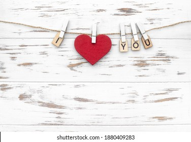 """The word """"I love you"""" with wooden letters and heart shape. Love theme. Wooden cubes with the word on pegs. Valentines day - Shutterstock ID 1880409283"""