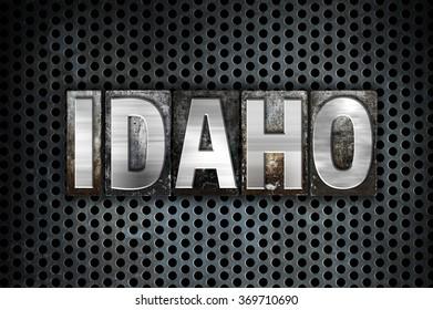 "The word ""Idaho"" written in vintage metal letterpress type on a black industrial grid background."