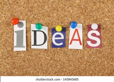 The word Ideas in cut out magazine letters pinned to a cork notice board. Ideas are the basis of creativity and success in business and life.