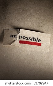 Word impossible transformed into possible and underlined