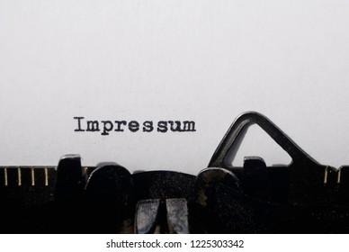the word impressum on old typewriter