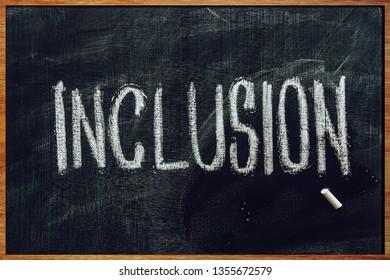 Word Inclusion on school blackboard written with chalk, inclusive education