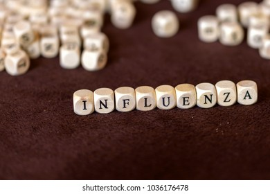 The word influenza created with wooden cubes