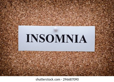 Word Insomnia on cork board. Close up.