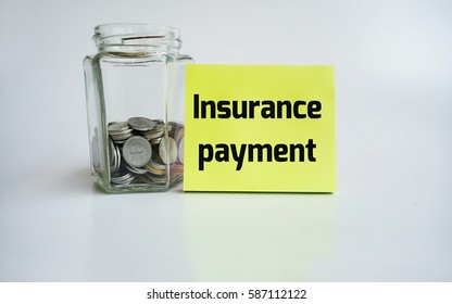 Word Insurance payment on sticky note and coin in the jug isolate on white background. Financial Concept.