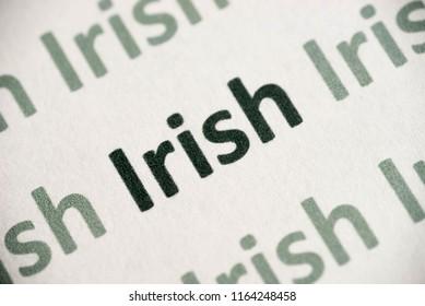 word Irish  language printed on white paper macro