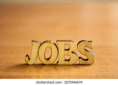 The word 'jobs' made of wooden letters. wood inscription on table
