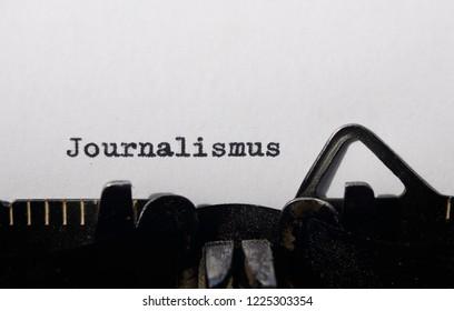 the word journalism on old typewriter