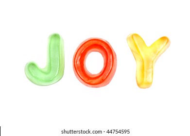 "A word ""JOY"" composed of candies"