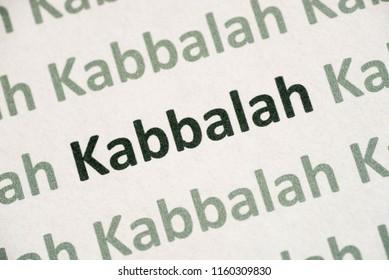 word Kabbalah printed on white paper macro