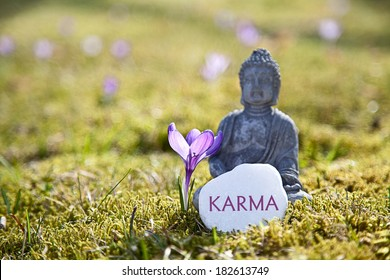 The Word Karma with Buddha Statue