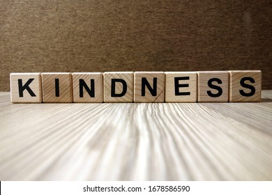 Word kindness from wooden blocks, friendliness and goodness concept