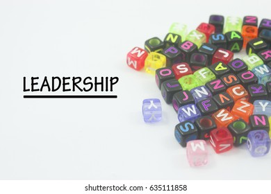 word leadership and alphabetical blocks isolated on white background