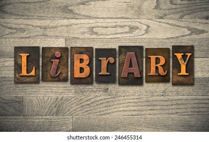 "The word ""LIBRARY"" written in vintage wooden letterpress type."