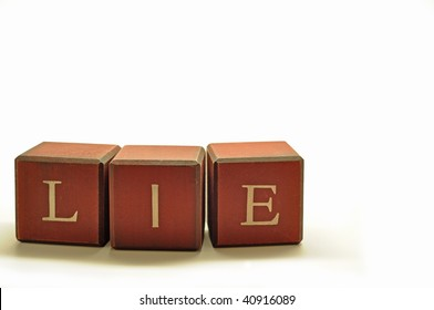 the word lie spelled out in rustic blocks