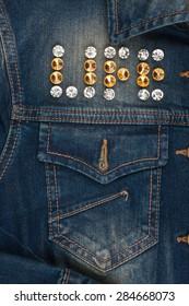 Word life made of rhinestones on denim jacket, as background