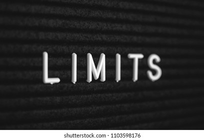 Word limits written on the letter board. White letters on the black background