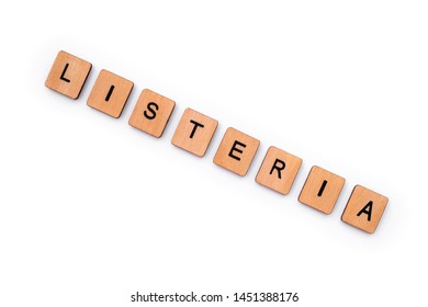 The word LISTERIA, spelt with wooden letter tiles, over a plain white background.