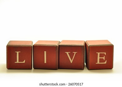 the word LIVE spelled out in rustic blocks