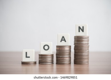 Word LOAN on step stack coins as graph up. Business and finance concept. Interest and fees from loans are main revenue for banks. Loans can be unsecured such as credit card.