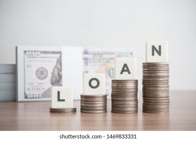 Word LOAN on step stack coins as graph up with banknotes background. Business and finance concept. Interest and fees from loans are main revenue for banks. Loans can be unsecured such as credit card. - Shutterstock ID 1469833331