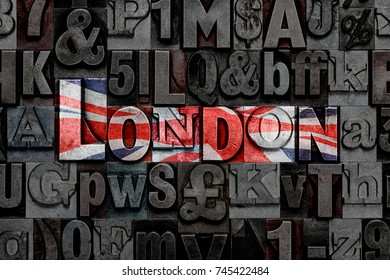 The word London made from old metal letterpress letters with Union Jack colours