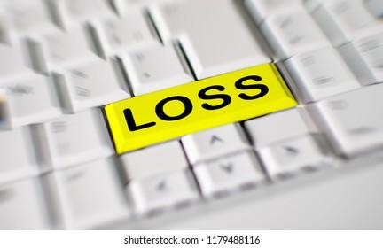 Word loss printed on an yellow computer keyboard key