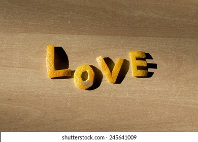 "Word ""Love"" with letters of an orange peel."
