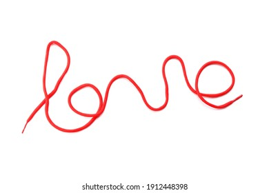Word Love made of red shoe lace isolated on white, top view