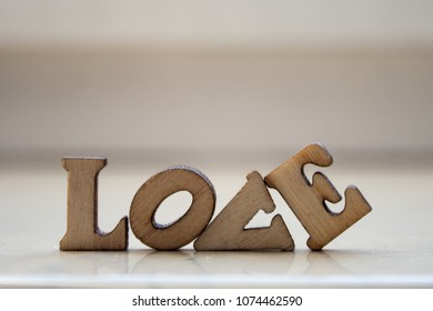 The word 'love' made of wooden letters. wood inscription on white background