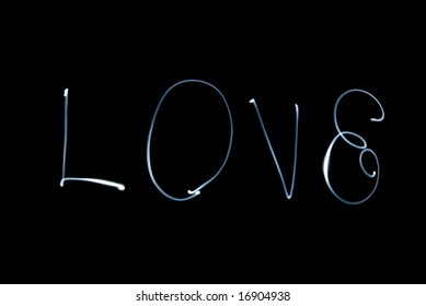 """Word """"love"""" on a black background"""