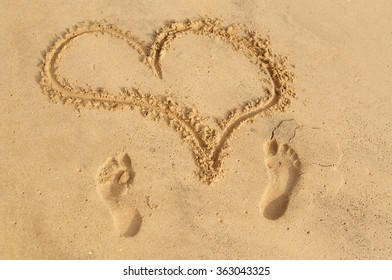 word 'love' on the sand