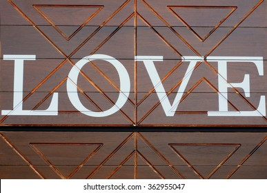Word LOVE on vintage wood background