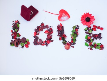 Word love on white background. Letters are made of dry roses