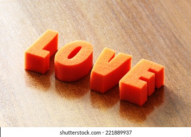 Word love on wood background