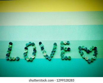 The word love from quiling on a green background
