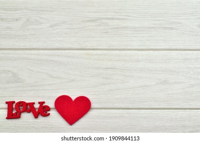 The word love with red felt letters and heart shaped felt