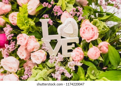 Word Love in wooden letters to decorate a wedding.