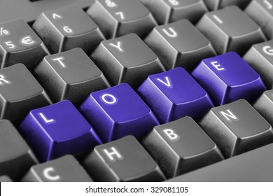 Word love written with blue keyboard buttons