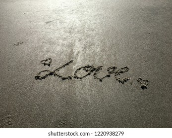 The word of love is written in the nice smooth sparkling white sands on the beach in the early morning with sun shines to the sands. When you love someone you want to tell the person and the world.