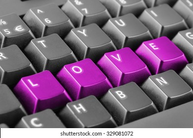 Word love written with pink keyboard buttons
