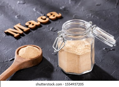 Word maca in wooden letters - Dry Organic Maca Powder. Lepidium meyenii