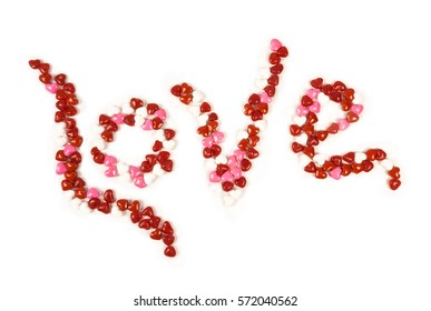 The word made with candy hearts on a white background.