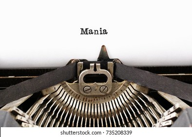 "The word ""Mania"" from a typewriter on a white background"
