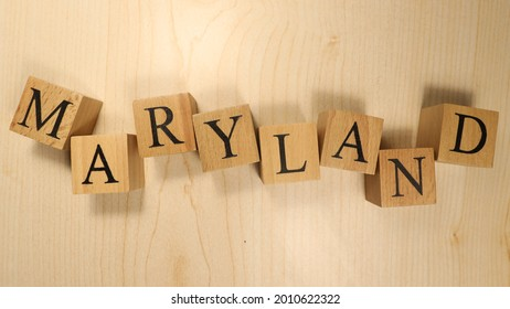 The word Maryland was created from wooden letter cubes. Cities and words. close up.